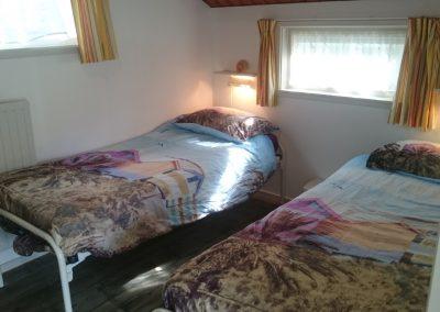 Boswei slaapkamer 2 met twee eenpersoonsbedden